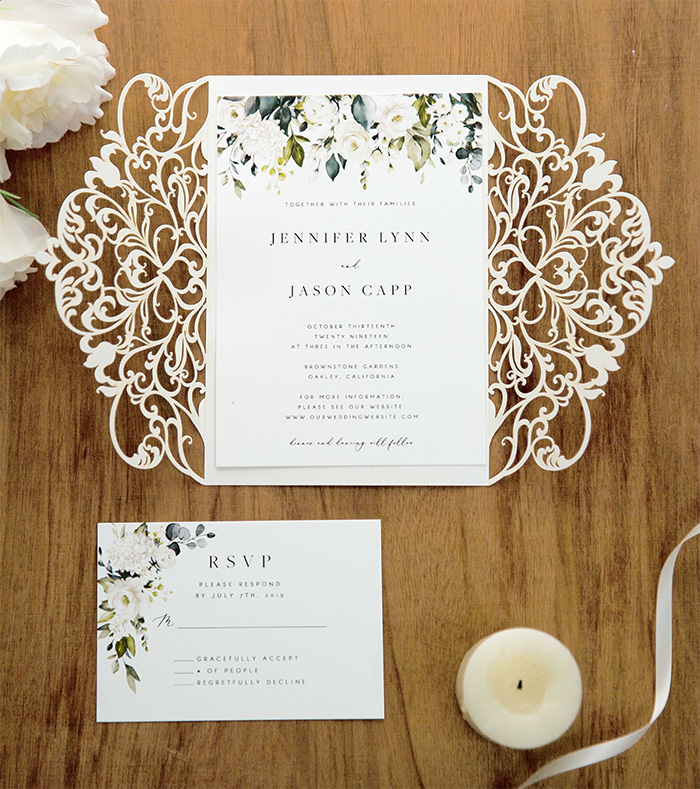 simple white and greenery laser cut wedding invites