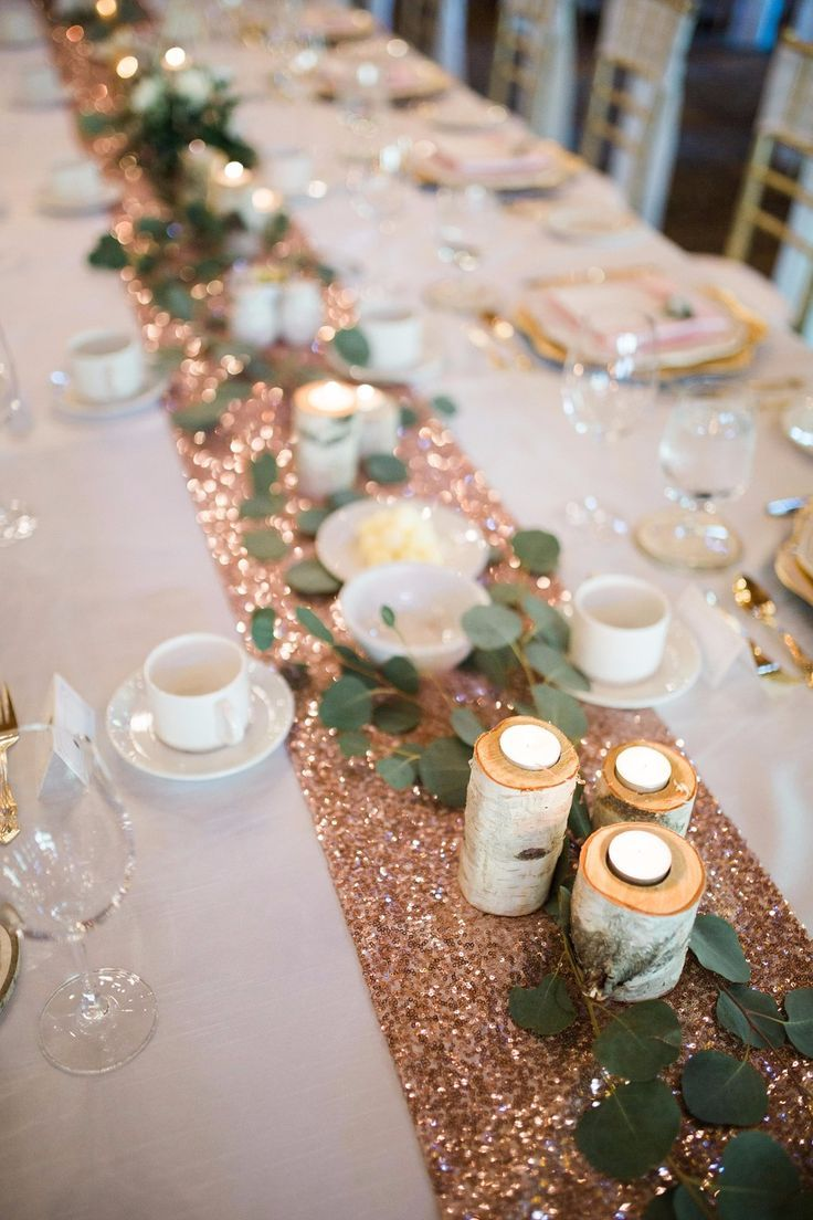 cozy rose gold table setting with candlelights