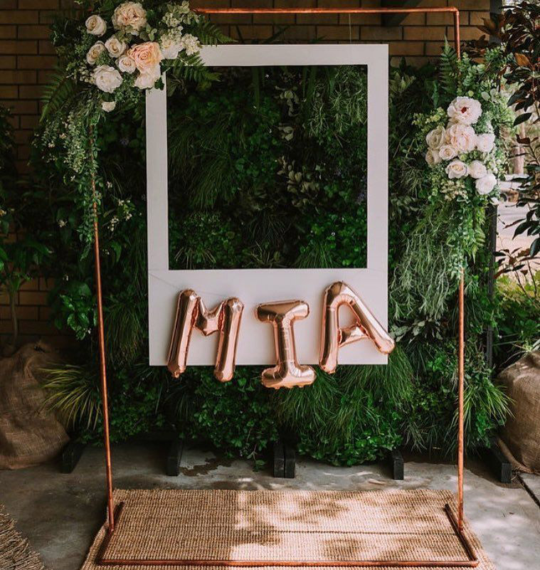 creative wedding photo booth with flower and rose gold ballon decoration