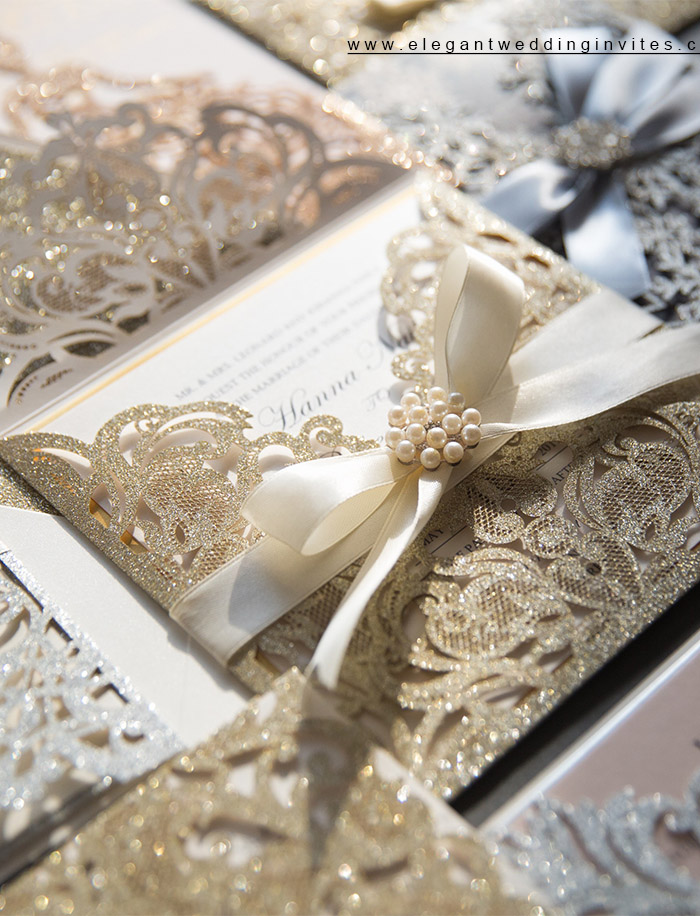 deluxe champagne glitter laser cut wedding invites with classic ribbon bow and diamond