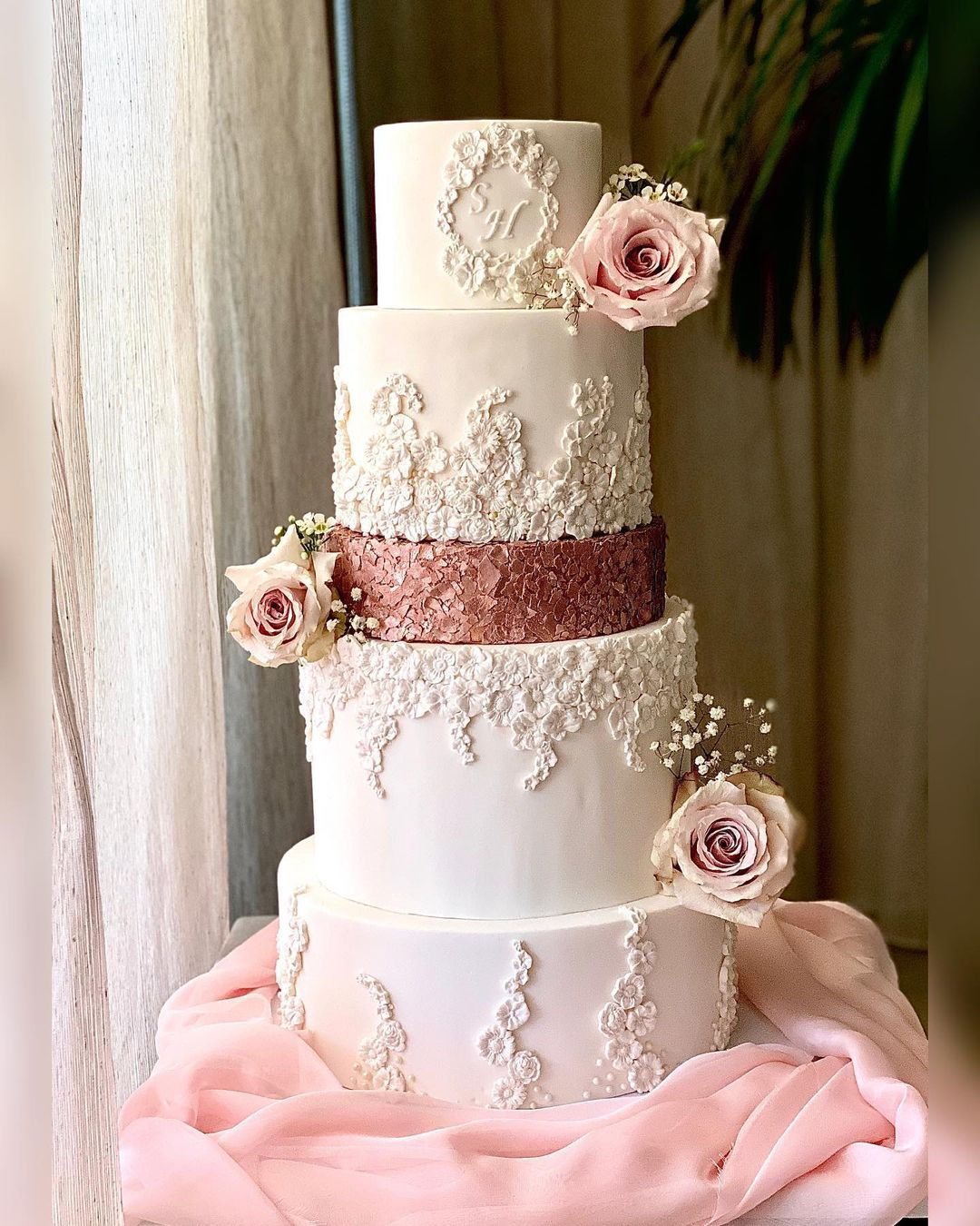 stunning regal white wedding cake with rose gold and flower details