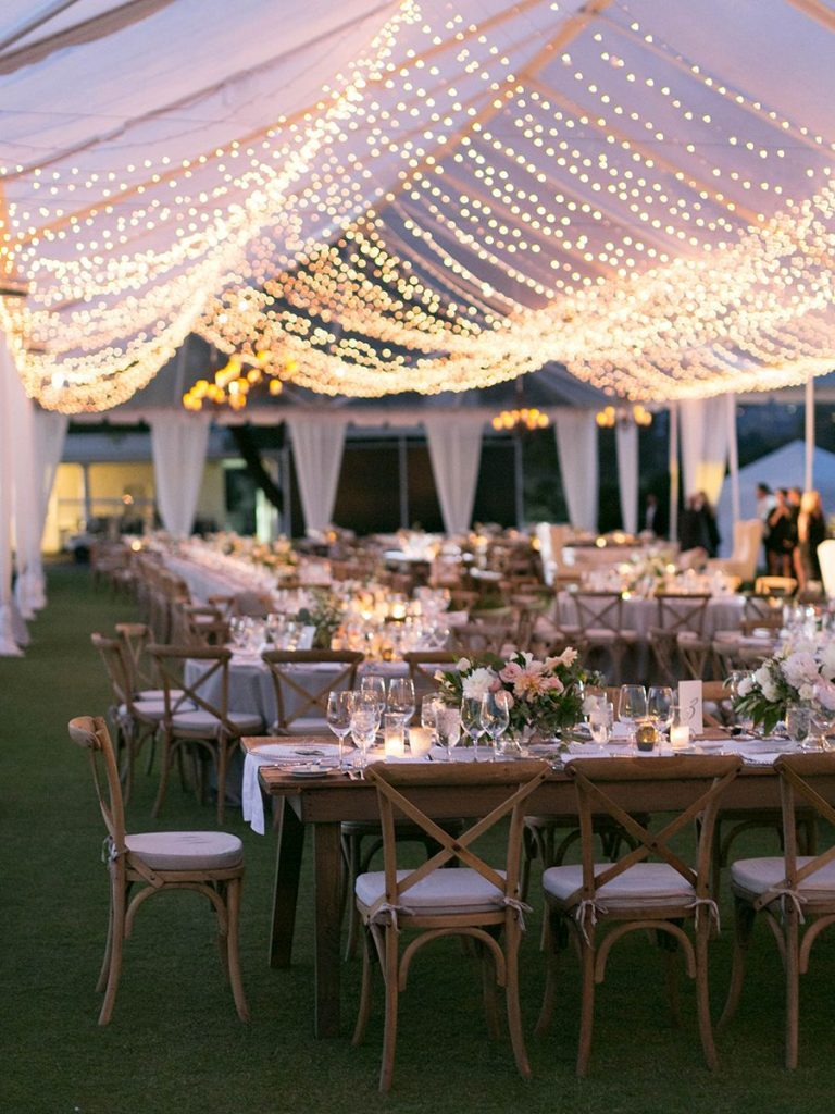 charming tented wedding with romantic string lights