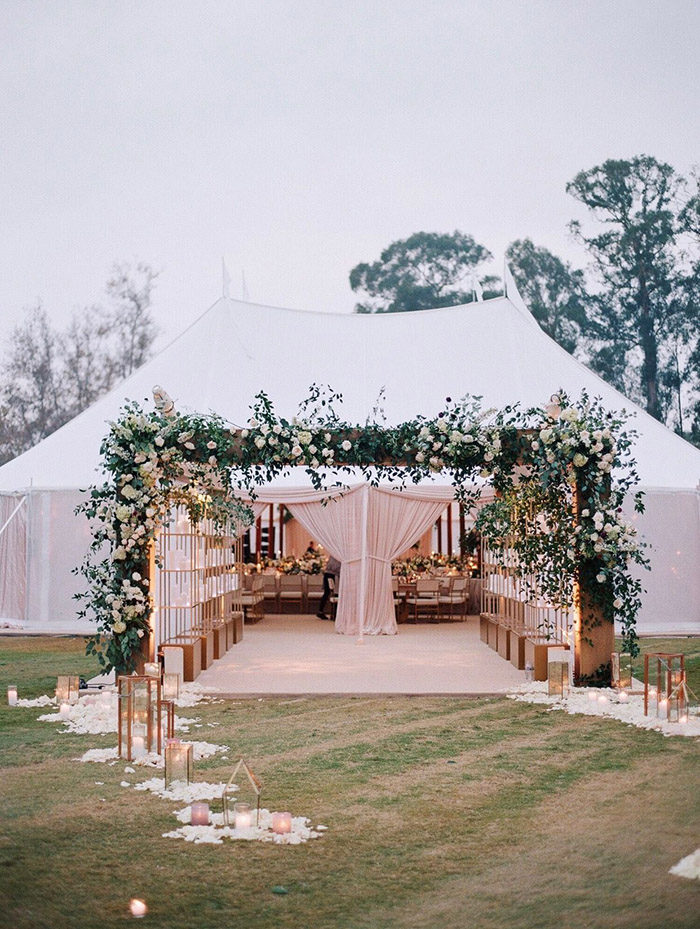 elegant and romantic outdoor tented wedding entrance decoration