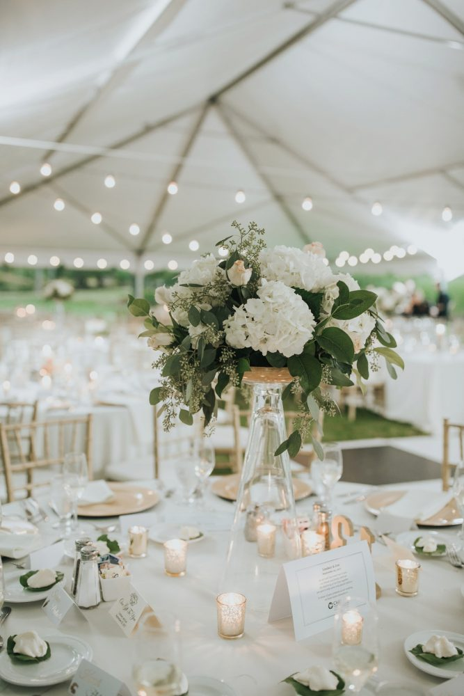 elegant white tented wedding centerpieces with candle lights