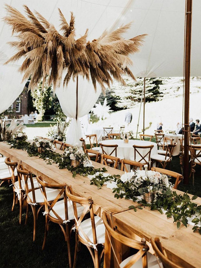 hanging pampass grass installation for a boho theme tented wedding