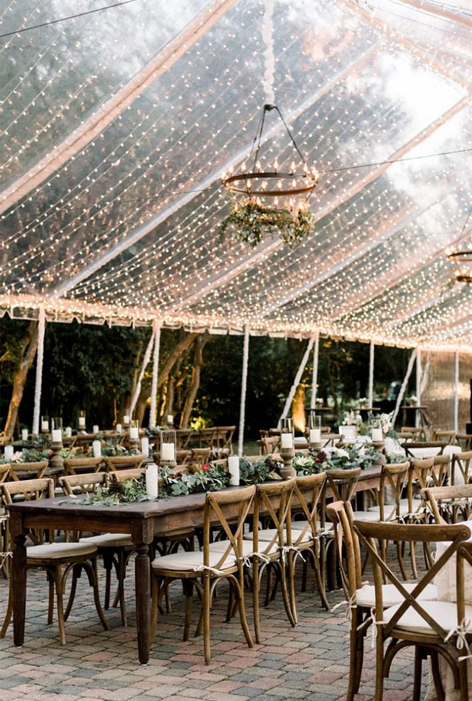 string lights decorated clear top wedding tent