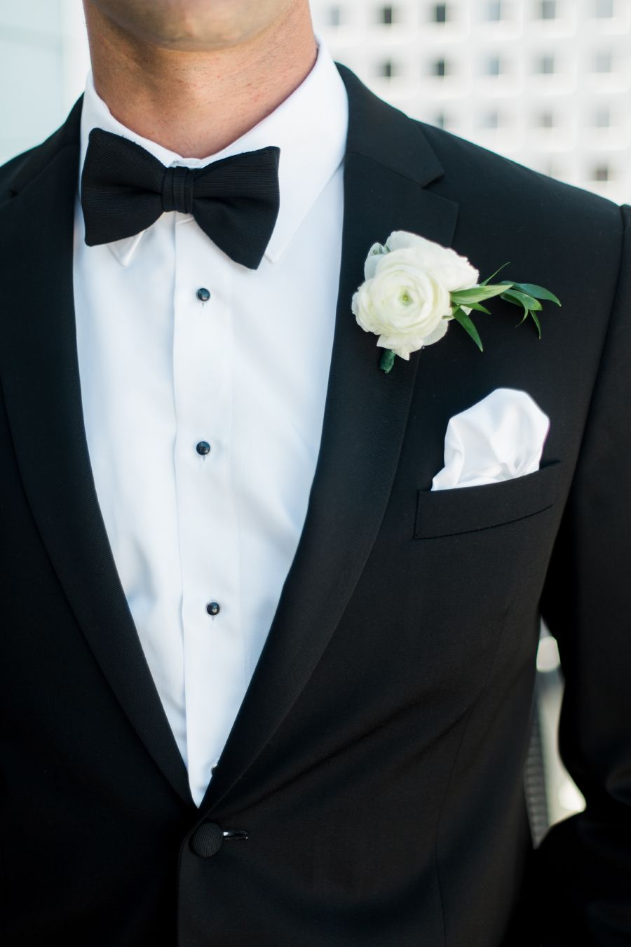 black and white modern groom attire
