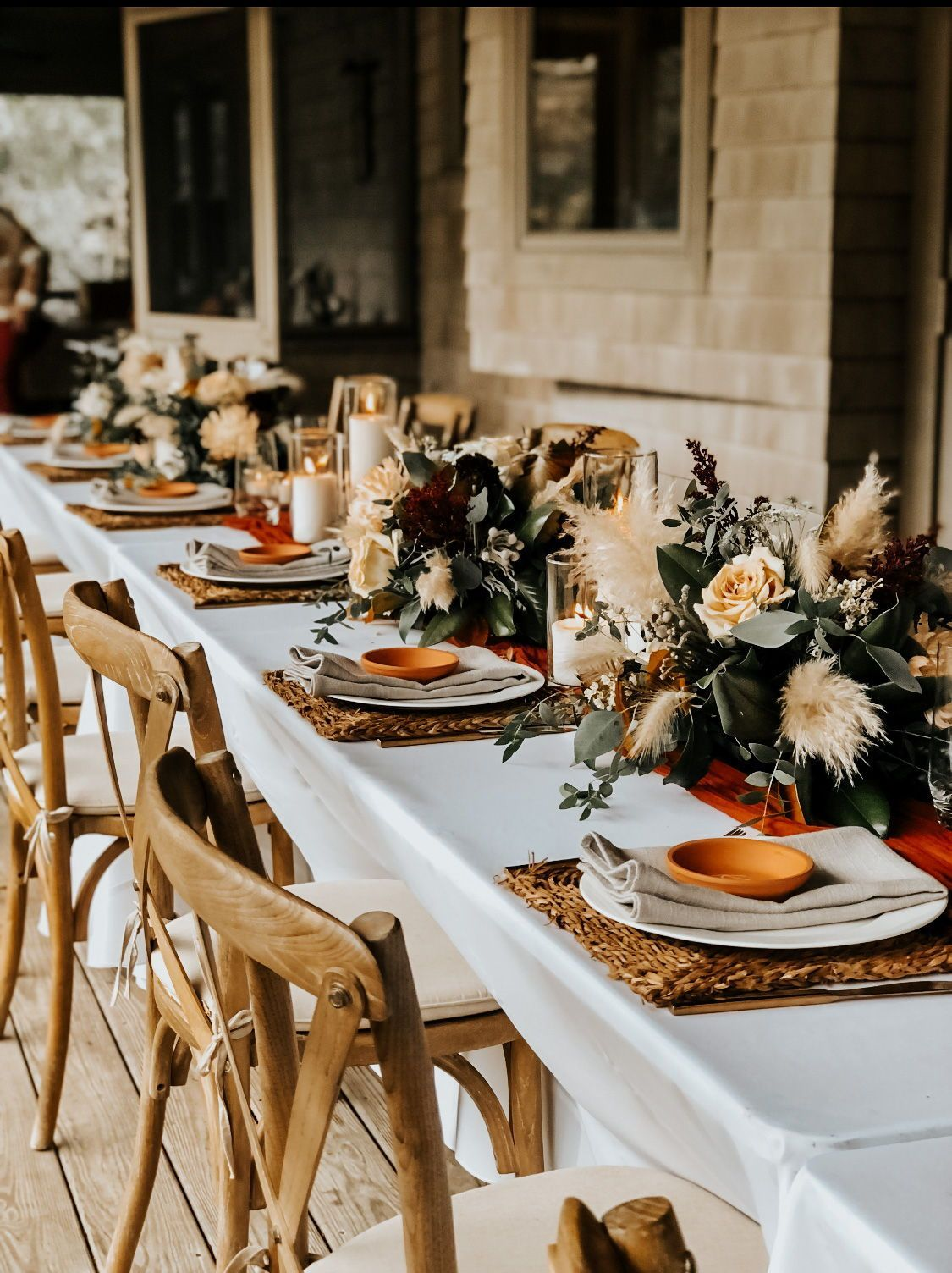 boho rustic wedding table settings with terracotta tablecloth