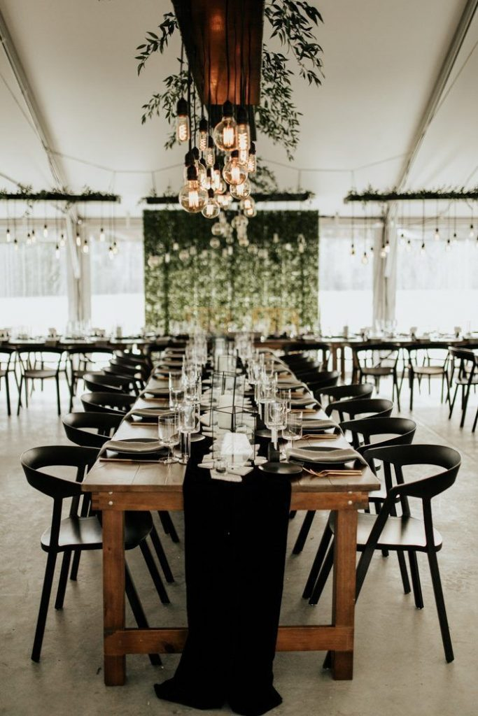cozy classic black and white wedding reception with natural setting