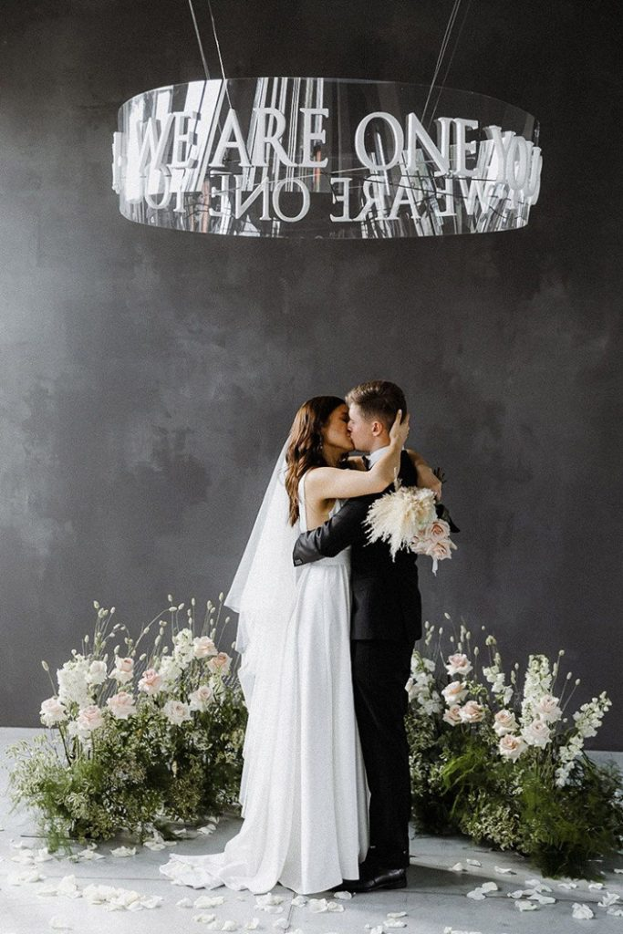 creative modern indoor micro wedding backdrop in black and white