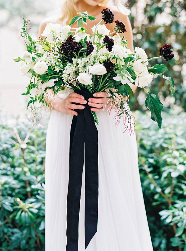 elegant organic black and white bridal bouquet with black ribbon