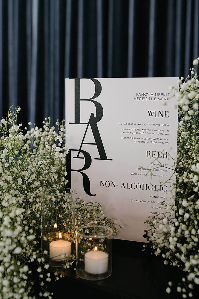 modern romantic black and white wedding bar menu decored with baby breath