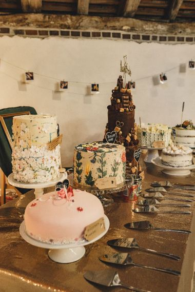 wedding cake table decored with hanging photo display ideas