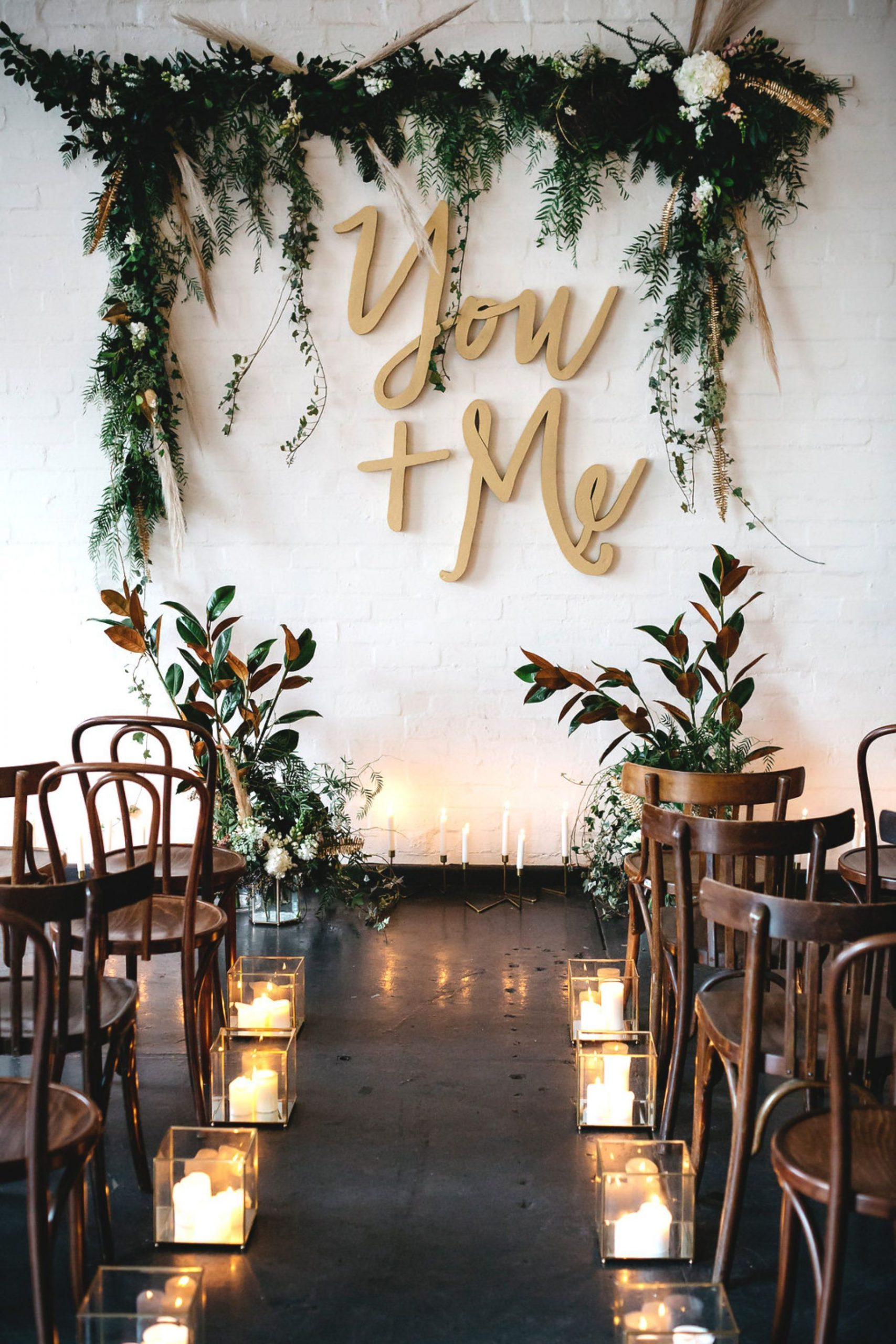 unique wooden wedding arch with emeral green leaves decor