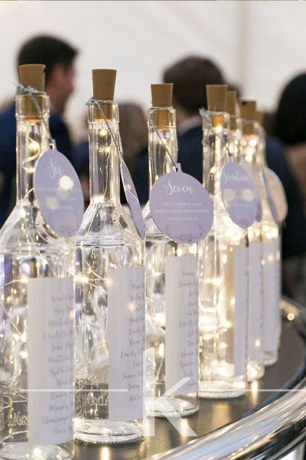 creative wedding centerpieces with light in bottle for winter wedding