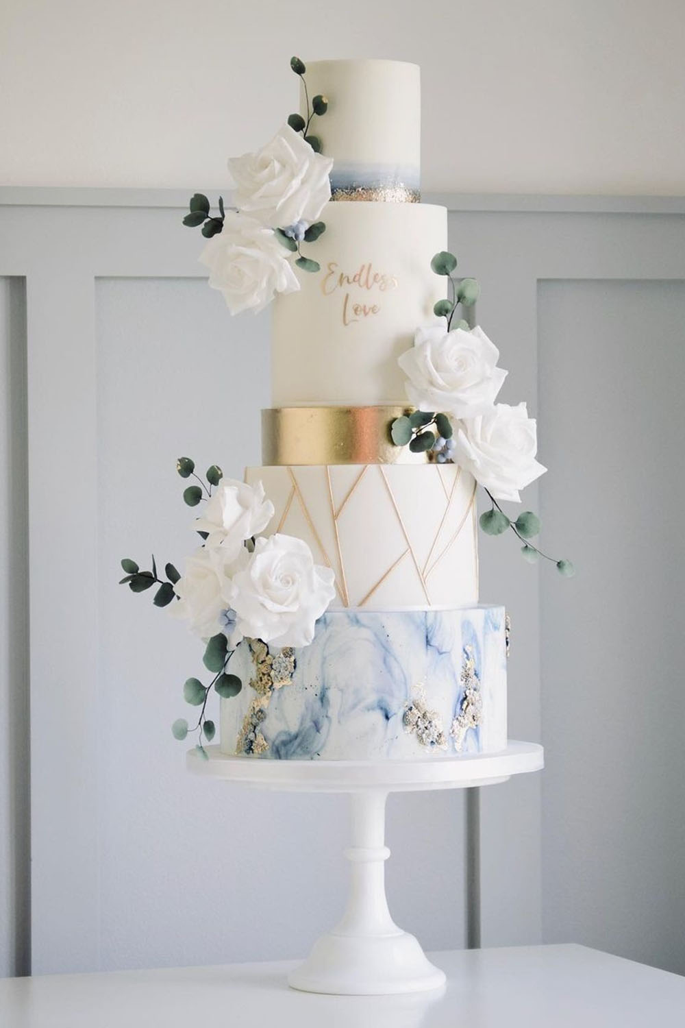 dusty blue textures and gold patterns winter wedding cake ideas