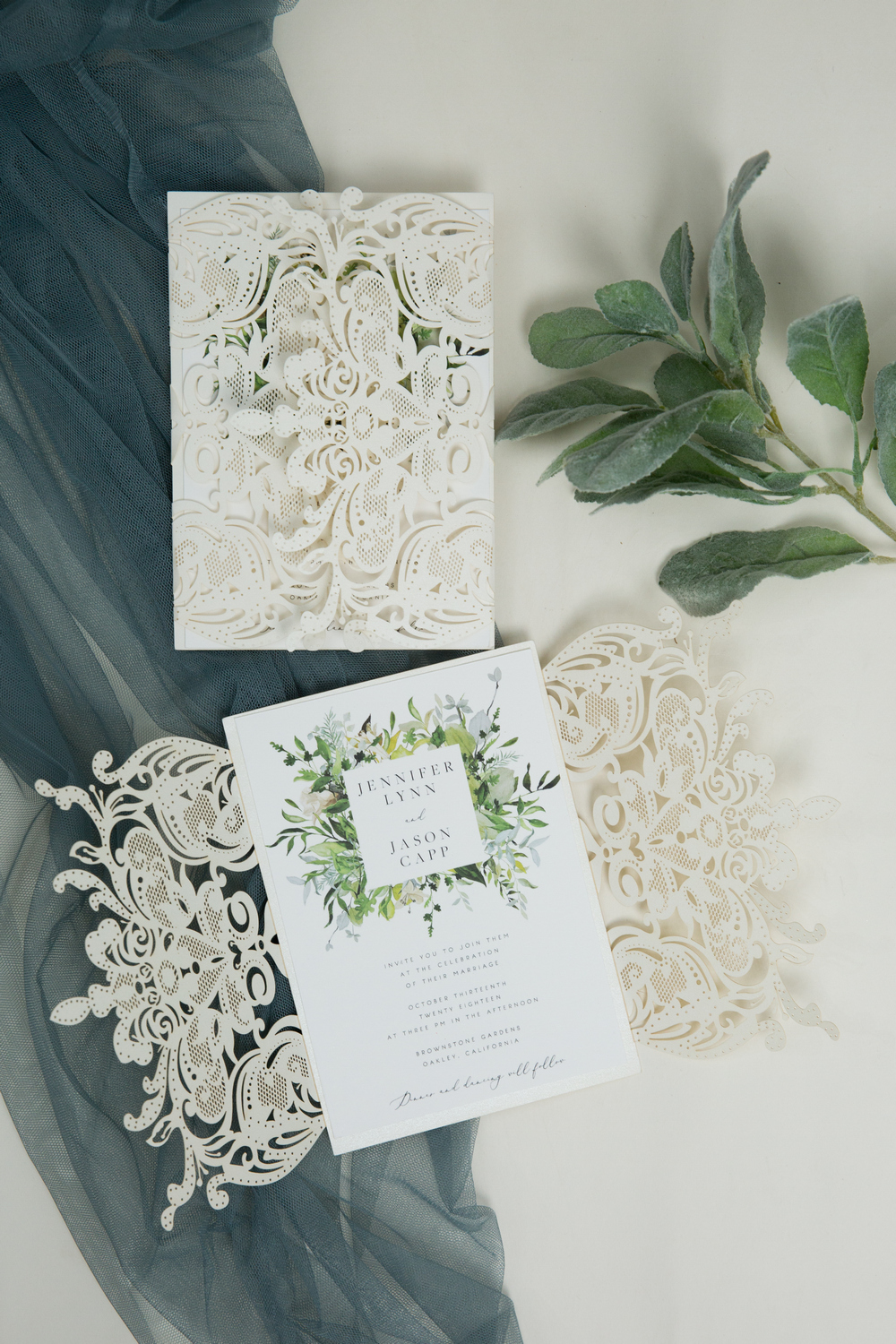 evelyn's garden lush greenery inspired invitation with ivory shimmer laser cut wrap