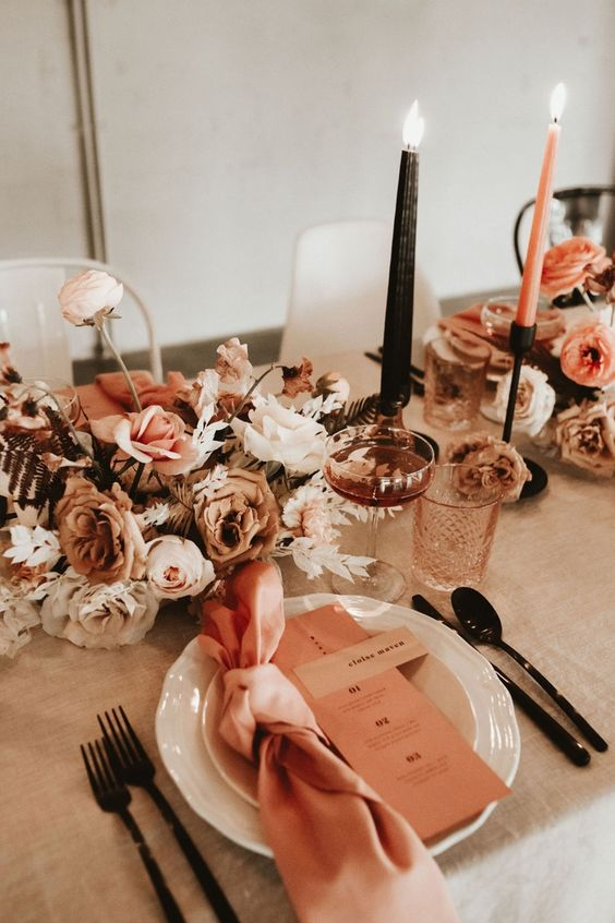 a chic fall wedding centerpiece of white blush and coffee colored blooms
