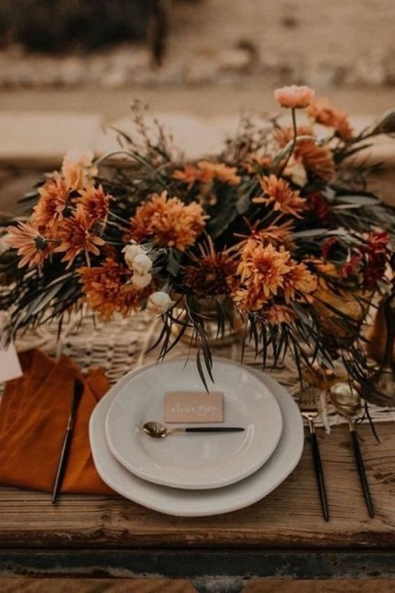 a fall terracotta wedding centerpiece decor of flowers and greenery 1
