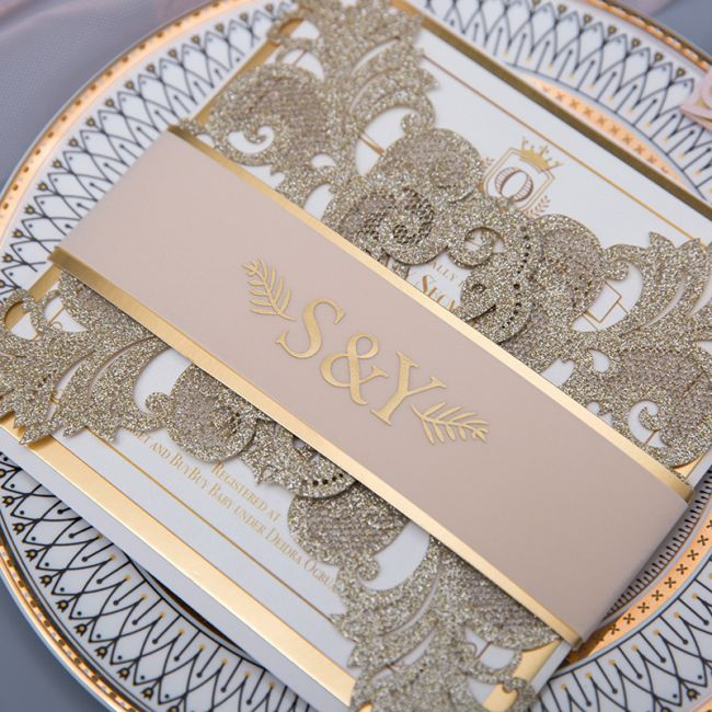 glittery gold laser cut wrap with vellum belly band and gold foil imprint ewws255