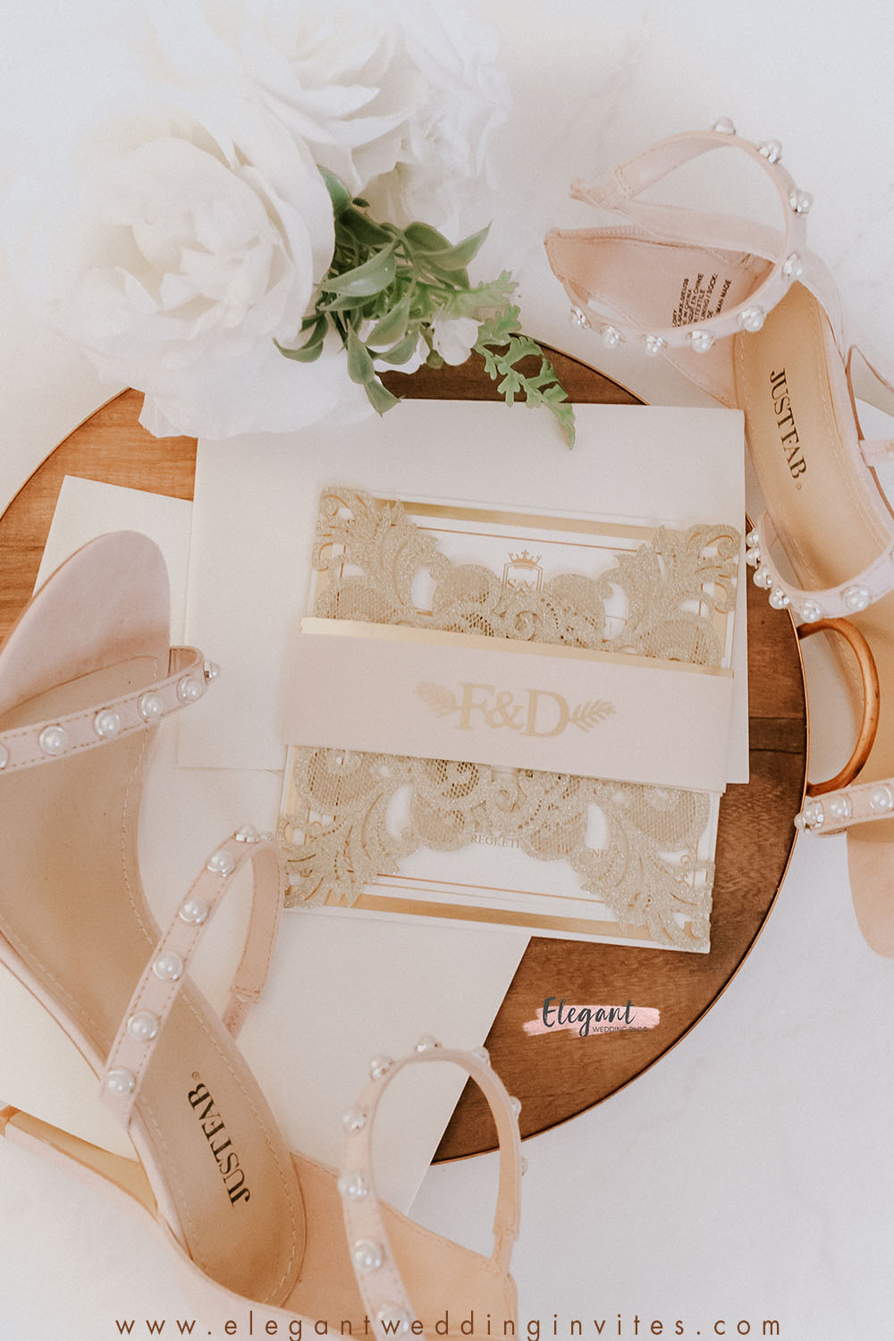 glowing in gold glittery gold laser cut wedding invitations with vellum belly band and gold foil imprint