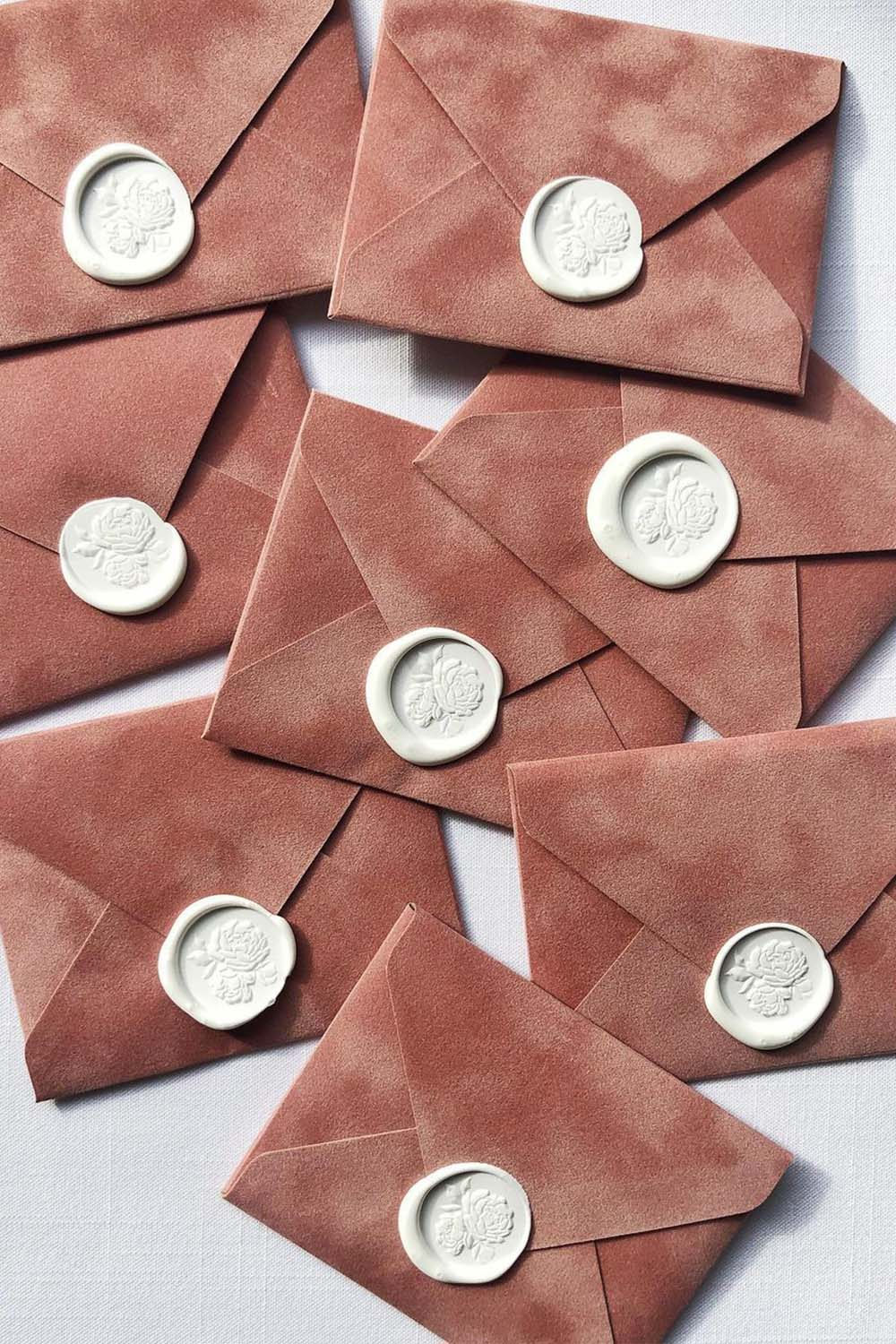 personalised wax seals for velvet outer wedding envelopes